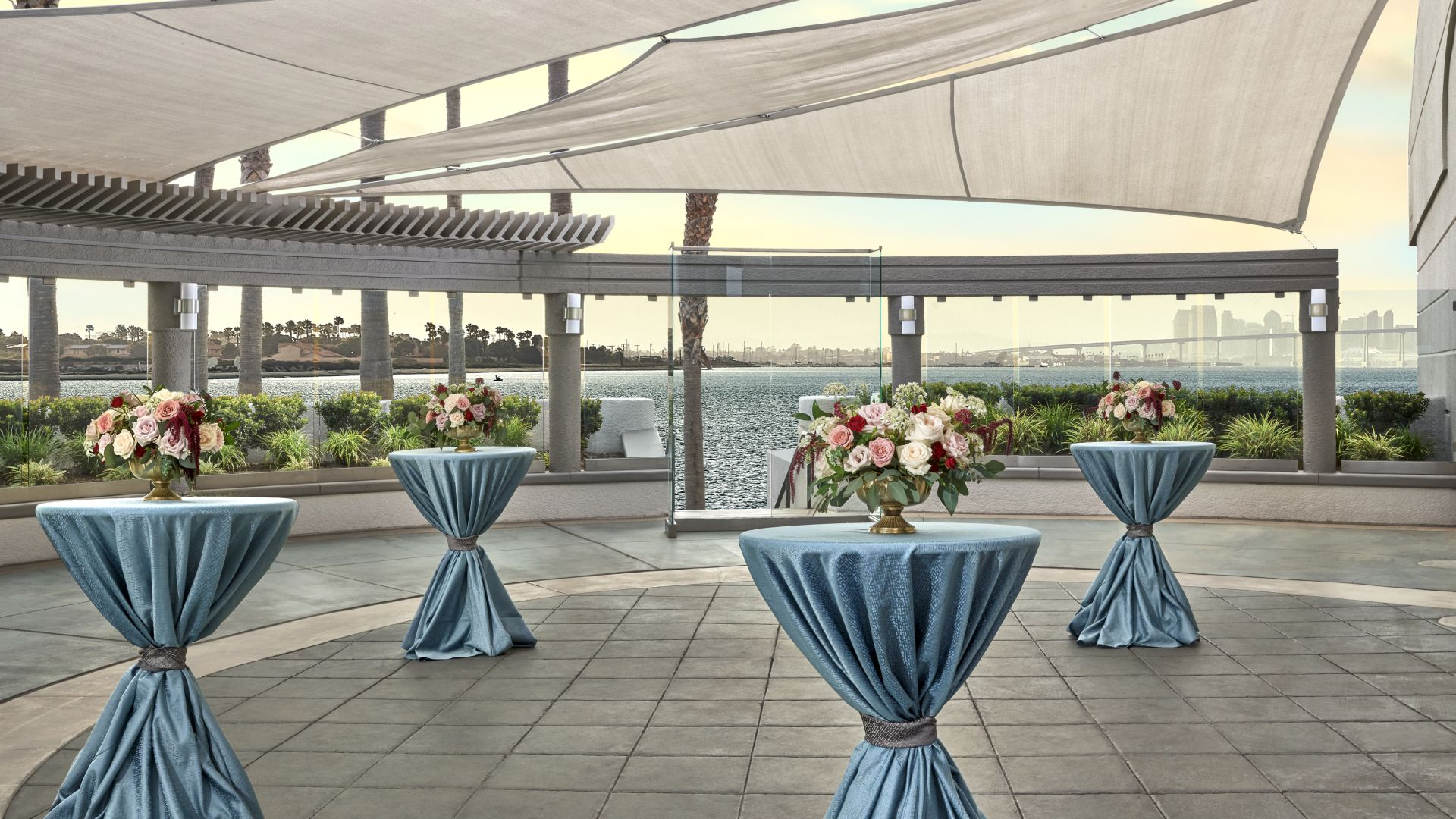 Terrace at sunset with high table rounds
