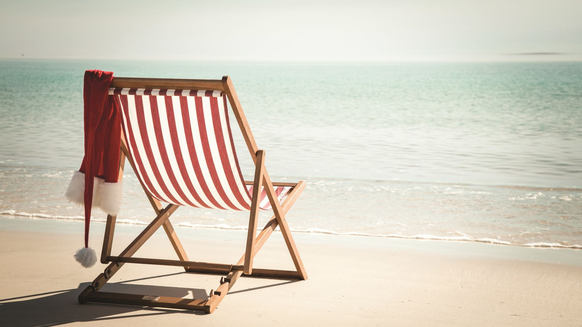 A Chair Sitting In Front Of A Beach