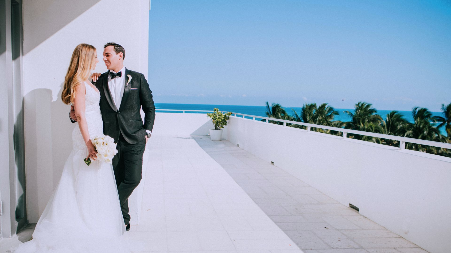 A Person Wearing A Suit And Tie Walking On A Sidewalk